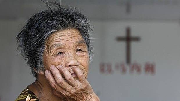 A churchgoer rests at a church in eastern China in August, 2012. The Chinese government maintains control of the practice of Catholicism and has shown little interest in negotiating with the Vatican to repair broken ties. Some Catholics have hope the new pope will be able to revive talks but don't think anything will change soon.