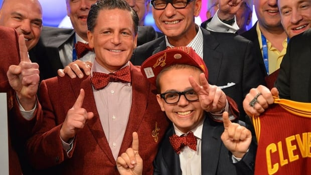 Owner Dan Gilbert, left, and son Nick Gilbert of the Cavaliers pose for a photo after winning the No. 1 overall pick during the NBA draft lottery Tuesday in New York.