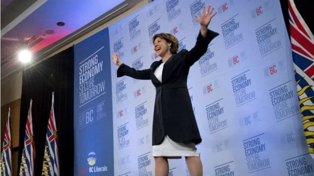 B.C. Liberal leader Christy Clark waves to the crowd after she arrives on stage after winning the British Columbia provincial election in Vancouver.