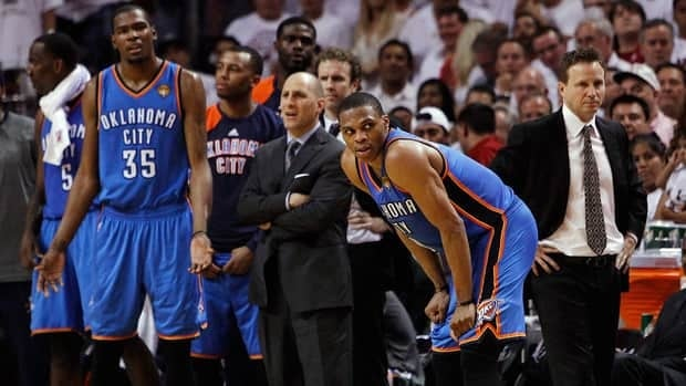 Oklahoma City Thunder players including Kevin Durant (35) and Russell Westbrook (0) to a call during the second half of their loss to the Miami Heat on Thursday.