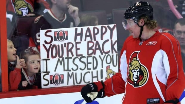 In this Jan. 13, 2013 file photo, Ottawa Senators team captain Daniel Alfredsson acknowledges two young fans who show their appreciation for his team coming back after the end of the NHL lockout.