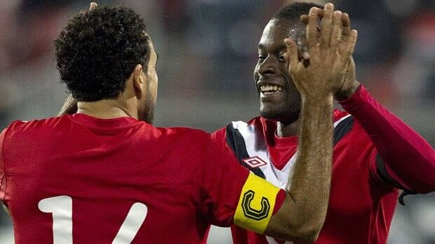 Canada's Tosaint Ricketts, centre, celebrates with Dwayne DeRosario after scoring his team's fourth goal against St. Kitts and Nevis during Round 2 of World Cup qualifying. Canada will next play at Cuba on June 8 before hosting Honduras on June 12.