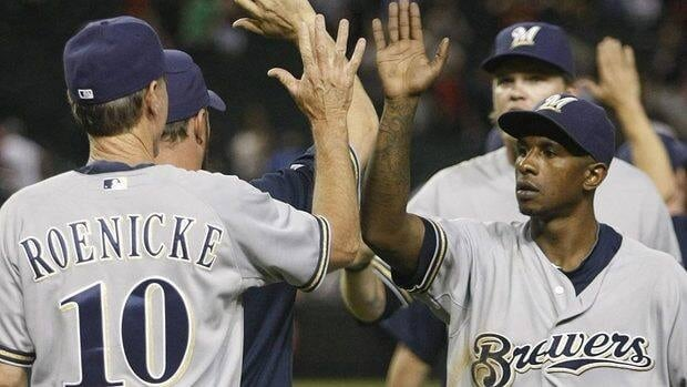 """Brewers manager Ron Roenicke would like to hear more from outfielder Nyjer Morgan, right. """"I'd rather have him step it up this year,"""" says Roenicke. """"It's really hard for him, because he's not playing that well, to be that guy he was last year."""""""