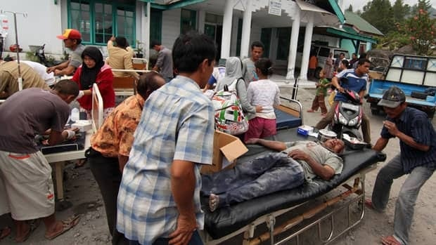 Victims receive medical treatment outside a community health centre in Bener Meriah, Aceh province, Indonesia, on Tuesday following a magnitude-6.1 quake.