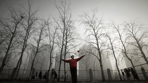 Thick fog and haze shrouds Beijing, where authorities have warned the elderly, the sick and children to remain inside.