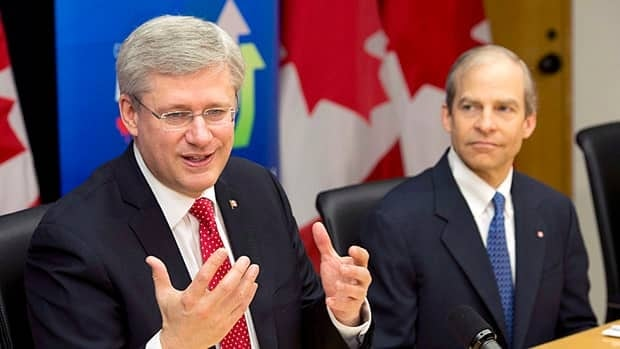 Prime Minister Stephen Harper, seen here with Fisk Johnson, the CEO of SC Johnson,  launched consultations for the proposed Canada Jobs Grant in Brantford, Ont., last month.  While some businesses have been enthusiastic, some provinces are less keen to participate.