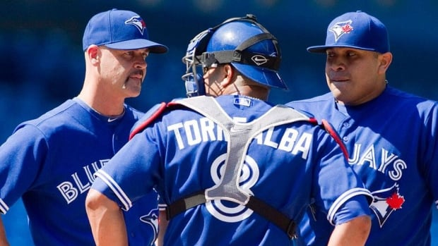 Blue Jays pitching coach Pete Walker, left, will get a chance to work closely this season with new starters R.A. Dickey, Josh Johnson and Mark Buehrle, along with returning left-hander Ricky Romero, right.