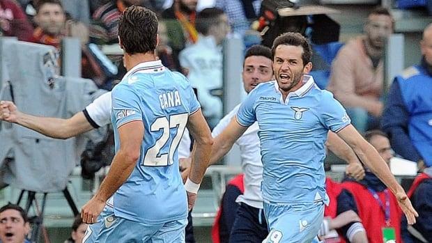 Senad Lulic of Lazio celebrates after scorig the opening goal against AS Roma  at Stadio Olimpico on Sunday in Rome.