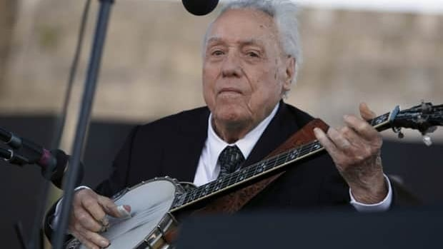 Earl Scruggs performs at the Bonnaroo Music & Arts Festival in Manchester, Tenn., in June 2005.