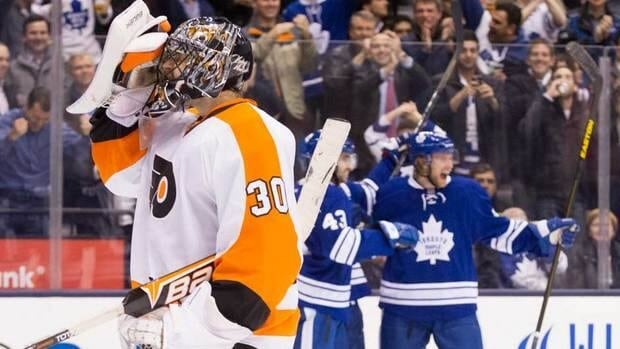 Philadelphia Flyers goaltender Ilya Bryzgalov, left, reacts after letting in his fourth goal as Toronto Maple Leafs defenceman Michael Kostka, right, and Nazem Kadri celebrate during second period action in Toronto on Monday.