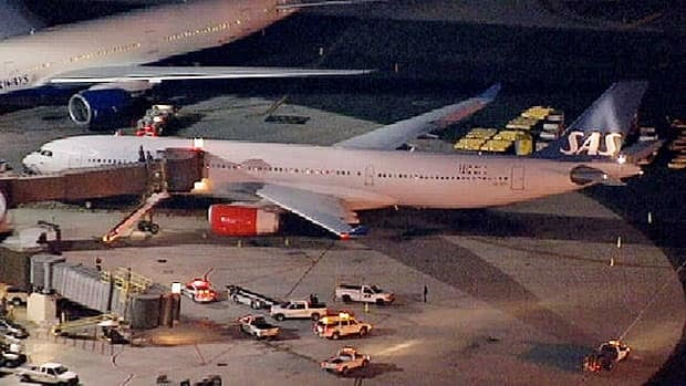 A damaged SAS Airbus A330 sits on the tarmac at Newark Liberty International Airport after clipping the wing of another aircraft on takeoff, Wednesday, May 1, 2013 in Newark, N.J. Federal Aviation Administration officials say no one was injured in the incident at about 7:30 p.m.