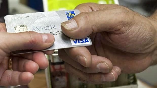 Average Canadian credit card debt fell in 2011 by 3.4 per cent, Equifax says.