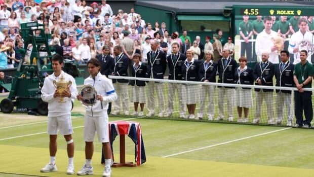 Novak Djokovic, left, and Rafael Nadal pose for photographers following the Wimbledon final in London, England, on July 3, 2011.