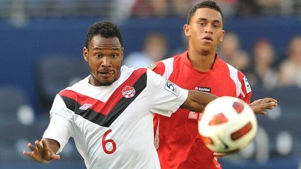 Julian De Guzman, left, and his Canadian teammates were stopped  from advancing out of the group stage at the 2011 Gold Cup by Eybir Bonaga, right, and Panama in a 1-1 draw.