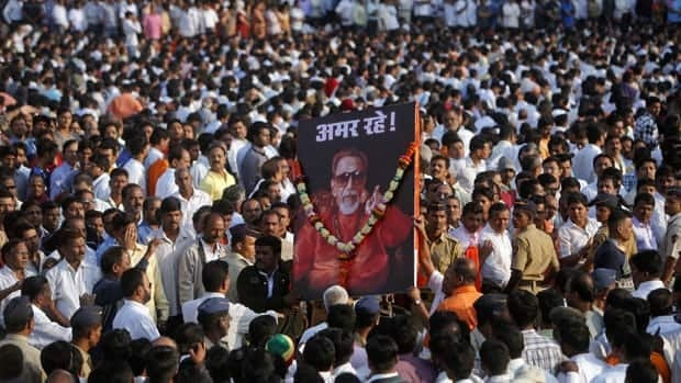 Supporters of the Shiv Sena party carry a portrait of right-wing Hindu nationalist politician Bal Thackeray before his funeral procession on Sunday in Mumbai.