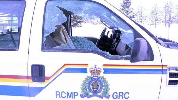 Two Fort Smith, N.W.T., men are facing charges after windows on an RCMP truck parked at the Fort Smith Hospital were smashed on the night of Feb. 14.