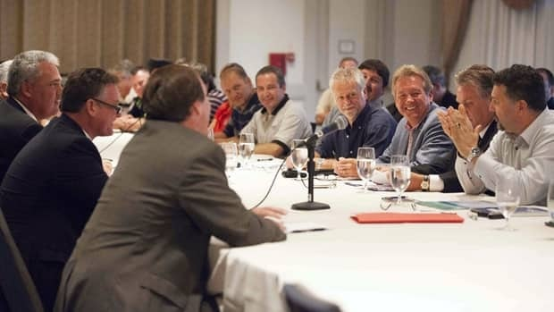 Bargaining teams from the CAW, right, and Chrysler open contract talks in Toronto, Aug. 14. The meeting was part of a series with the big three automakers.
