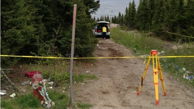 RCMP remain on scene where a woman's body was found on Friday in Sheshatshiu, in central Labrador.