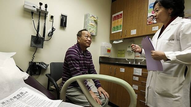 A man with diabetes consults a medical assistant in Seattle, Wash. A new study suggests that genetic testing is not the best way to predict who will develop the disease.