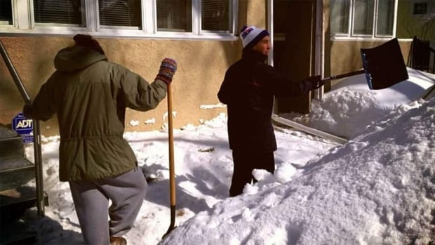 On Monday, Warren Lister and his daughter Brooke were busy moving snow away from their Regina house.