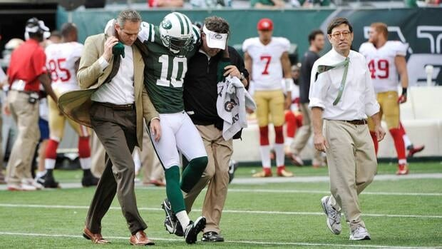 New York Jets wide receiver Santonio Holmes is helped off the field after being injured in the second half of the game against the San Francisco 49ers on Sunday.