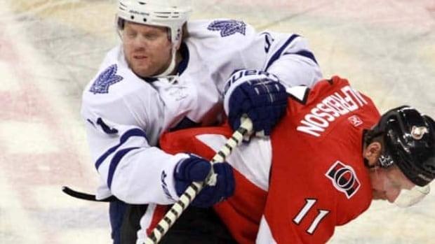 Toronto Maple Leafs' Phil Kessel (81) is checked by Ottawa Senators' Daniel Alfredsson (11) during first period NHL hockey action in Ottawa on Saturday Nov. 27, 2010.