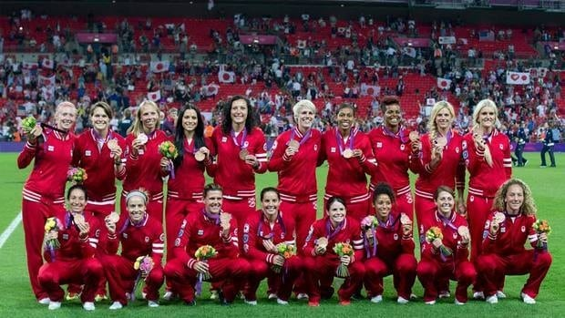 Frank Gunn/Canadian Press Canada's women's soccer team shows off bronze medals at London Olympics 2012