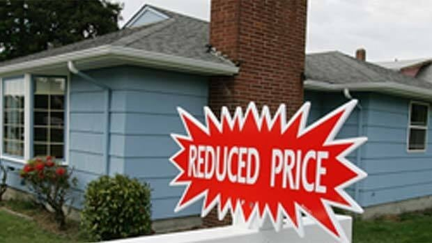 Real estate prices are dropping in Vancouver, but there's disagreement among experts as to how deep the cuts will be.