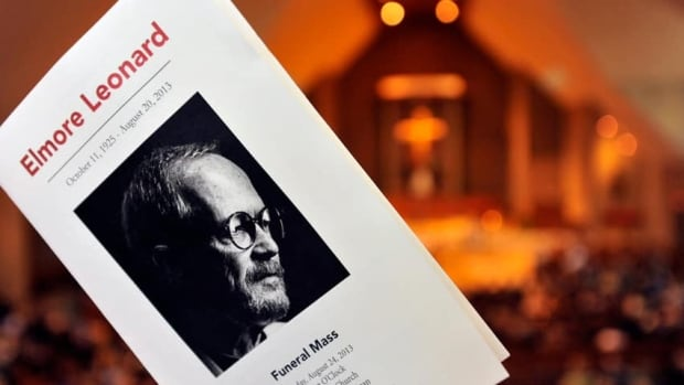 A black and white portrait of novelist Elmore Leonard on the program for his funeral mass in Birmingham, Mich. Leonard's son Peter will complete his final novel, Blue Dreams.