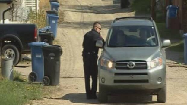 Police are investigating after a handgun was discovered in a northwest Calgary alley.