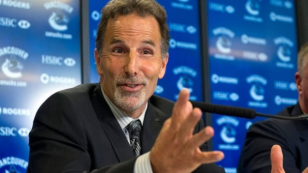 Canucks head coach John Tortorella smiles while answering a question during his introductory news conference on Tuesday. The former Rangers bench boss vows to work at his relationship with reporters.