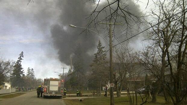 Heavy smoke fills the air Friday afternoon during a garage fire on Wexford Street in Charleswood.