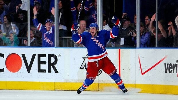 Michael Del Zotto, shown in this file photo after scoring a playoff goal against the Washington Capitals in New York City in May, re-signed with the Blueshirts on Sunday.
