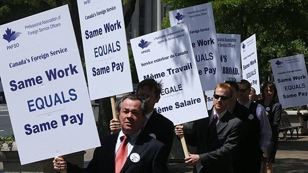 Canadian foreign service officers protest in front of the Canadian embassy in Washington on May 3, 2013. The ongoing labour dispute with the government is starting to slow down visa applications for tourists and students.
