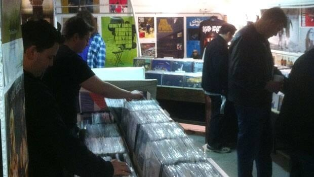 Customers at X-Ray Records in Regina look through stacks of vinyl records on Saturday.