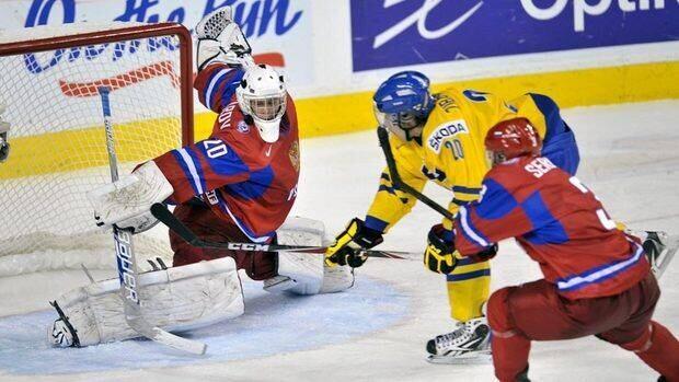 Sweden's MikaZibanejad scores on Russia goaltender AndreiMakarov in overtime to win the world junior hockey championship gold medal Thursday.