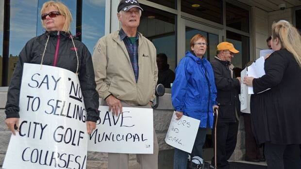 A group of golfers outside of Thunder Bay city hall petition to keep Municipal Golf Course open.