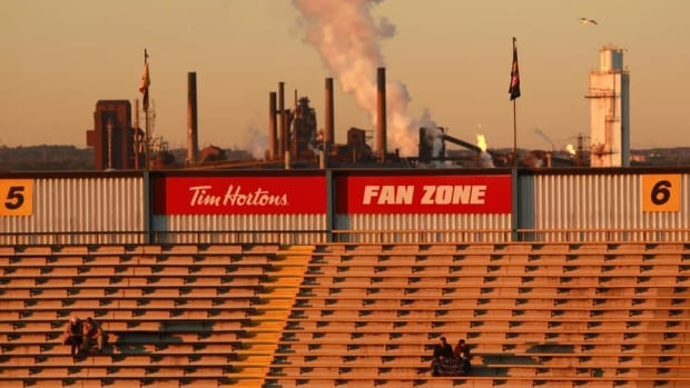 Fans sit in Ivor Wynn Stadium ahead of a Hamilton Tiger-Cats home game on Oct. 12. The city's new facility is being built on the same grounds where Ivor Wynn used to stand.