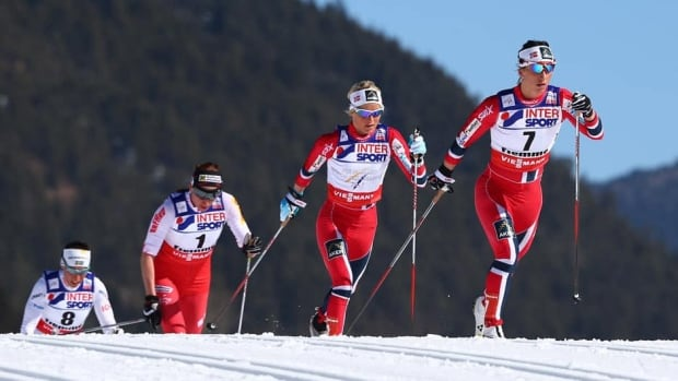 From right, Marit Bjoergen of Norway, Therese Johaug, of Norway, and Justyna Kowalczyk, of Poland, compete at the Nordic Ski World Championships in Val di Fiemme, Italy on Saturday.