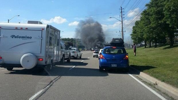 Traffic was backed up on Homer Watson Boulevard near Beasley Drive after a car was engulfed in flames.