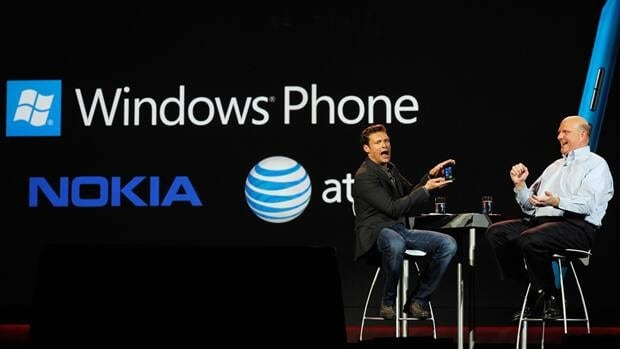 Nokia and Microsoft, who collaborated on the new Lumia smartphone, impressed journalists at the 2012 Consumer Electronics Show in Las Vegas. Here, host Ryan Seacrest, left, holds the new phone during Microsoft CEO Steve Ballmer's keynote address at CES on Jan. 9.
