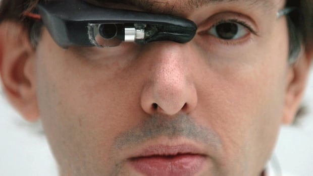 Steve Mann wears an EyeTap digital eye glass in 2003. The computer engineer and inventor has been wearing some form of digital imaging device on his person for decades.