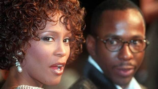 The late Whitney Houston is shown with husband Bobby Brown on Oct. 13, 1997. Houston's mother, Cissy, has written a tell-all memoir that blames Brown for her daughter's long involvement with drugs.