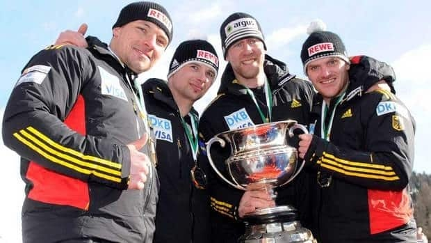Germany's Maximilian Arndt, Marko Huebenbecker, Alexander Roediger and Martin Putze, from right, celebrate on the podium after winning the 4-man bobsled competition at the Bob World Championships in St. Moritz, Switzerland on Sunday.