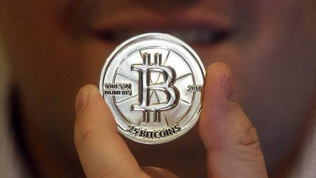 Bitcoin, a virtual peer-to-peer currency, as represented by a physical coin.