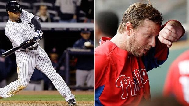 Former Blue Jays Vernon Wells, left, and Roy Halladay are headed in opposite directions. Wells is hitting .360 as a New York Yankee while Halladay sports sports an ugly 14.73 ERA in two starts with Philadelphia.