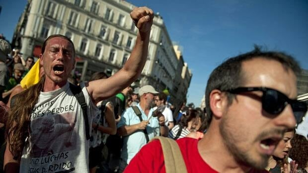 Protestors stage anti-austerity demonstrations at Madrid's Puerta del Sol square Tuesday.