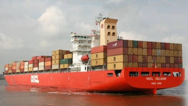 The container ship OOCL Belgium, pictured above, got stuck in heavy ice on the Strait of Belle Isle and requested help from the coast guard on Thursday morning.
