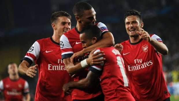 Arsenal players celebrate a goal against Fenerbahce at Sukru Saracoglu Stadium in Istanbul on August 21, 2013.