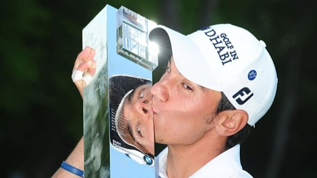 Italy's Matteo Manassero celebrates with the PGA Championship trophy after round four on day four of the PGA Championship at the Wentworth Club, Virginia Water, England on Sunday.